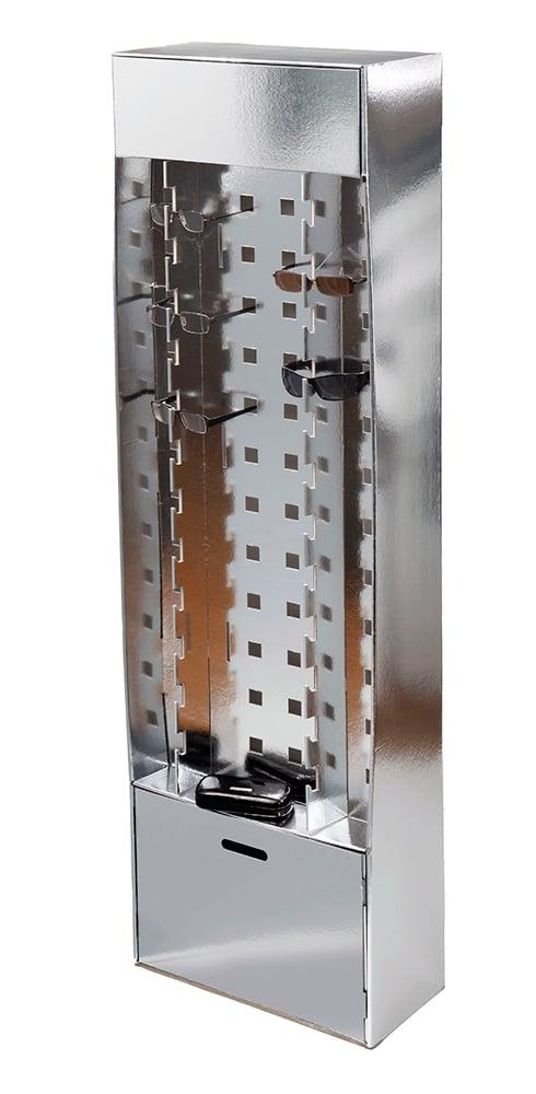 Erittäin näyttävä myyntiteline silmä- ja aurinkolaseille. Telineessä on myös kätevä laatikko varastoa varten. Mallitelineemme on valmistettu hopeafolioidusta kaksikerrosaaltopahvista. Luxusta pieneen lisähintaan.